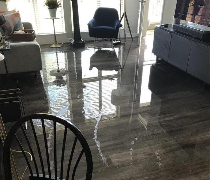 Water sitting on top of apartment floor